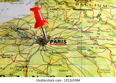 Close up of Paris on a map with red pin