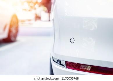 Close up of parking sensor at rear car bumper.