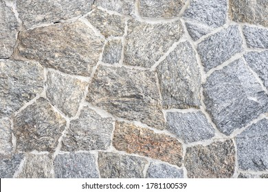Close up part of a stone wall rustic grunge seamless texture background