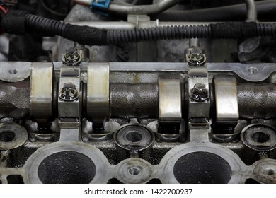 Close up of parts in a car engine head two camshaft system