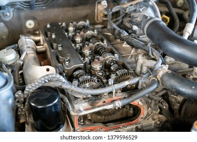 Close up of parts in a car engine twins camshaft system with Roller timing chain. - Overhaul servicing of vehicle