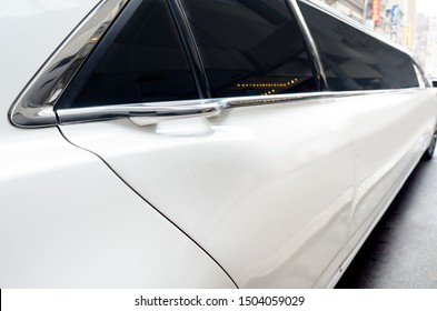 Close up of passenger door of a white stretch Limousine.