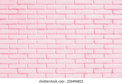 Close up pastel pink color blocking of brick wall room texture background
