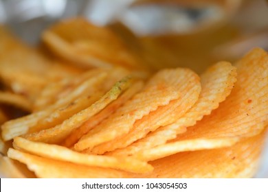 Close up of patato chips in foil bag.