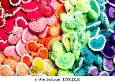 close up pattern of colorful crochet heart shape from top view or flat lay