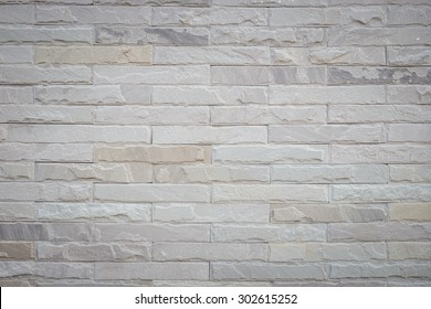 Close up pattern grey sandstone wall background and texture