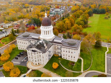 Close to the peak of fall color in the leaves at the State House of Main in Augusta USA