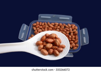 close up of peanuts on blue background