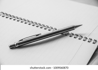close up pen and book in black-white tone