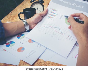 Close up pen of businessman pointing on chart.