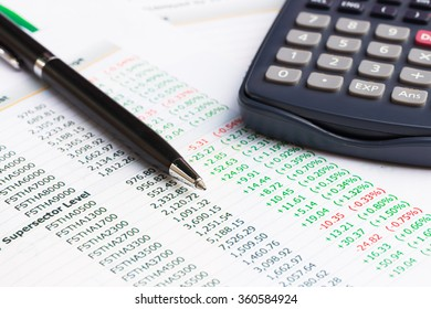 Close up of Pen with financial graphs,Business concept.