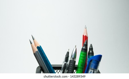 close up of pen holder with pens and pencils