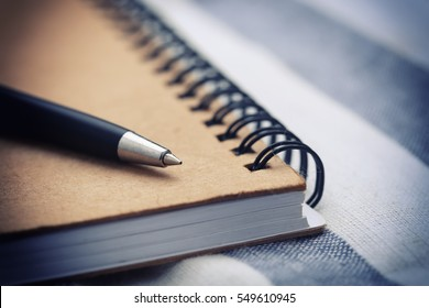 Close up of Pen and notebook on wooden table,Concept of education.