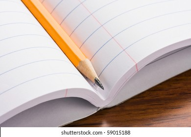 Close up of pencil on top of a notebook.  Concept of education.