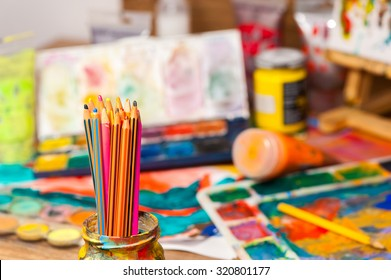 Close up pencils art supplies paints for painting and drawing