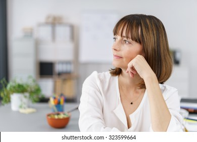 Close up Pensive Office Woman Looking Into the Distance While Leaning on her Elbow.