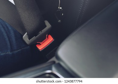 Close Up of people fastening seat safety belt in car for safety before driving on the road. concept transport travel.
