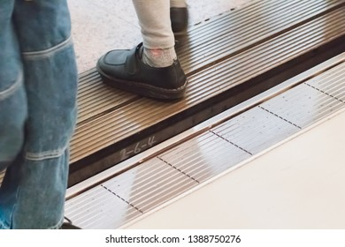 Close up people feet walking over the gap between a metro train and platform. People can fall into this gap and get injured