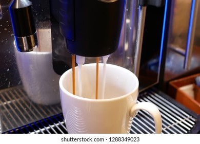 Close up of people having a cup of coffee at food cafeteria inside restaurant