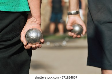 close up of people at sport,seniors playing the french game petanque