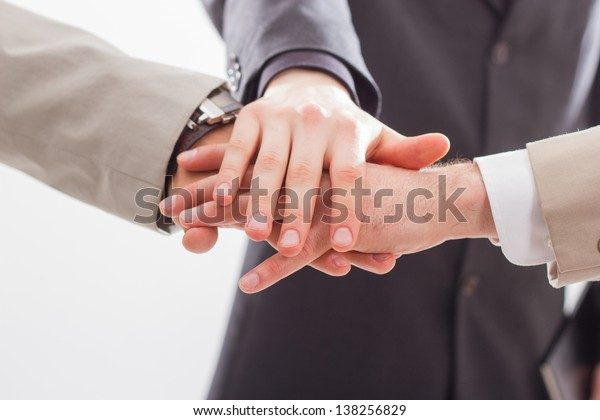 Close up of people that hold hands together. Isolated on white background.