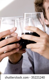 Close up of people toasting with wine glasses