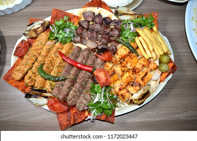 Close up of Persian Mix Kebab consisting meat, chicken and steak with french fries