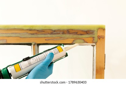 Close up of a person applying dry seal to restored sash windows.