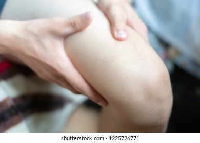 close up person touch the knee feeling the bone pain, suffer from pain