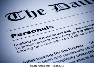 Close up of personal ads on newspaper