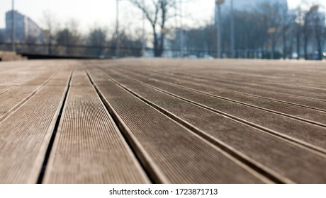 Close perspective of wooden decking floor, blurry background