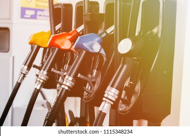 Close up of petroleum gasoline station service - oil refueling and refilling for car transportation concept
