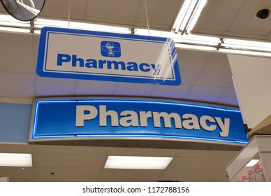 Close up of pharmacy sign hanging on store