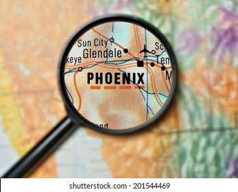 Close up of Phoenix, Arizona under a magnifying glass on a map