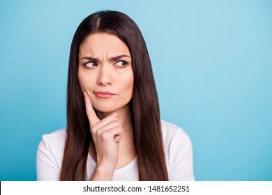 Close up photo of amazed wondered interested girl contemplating something away while isolated with blue background
