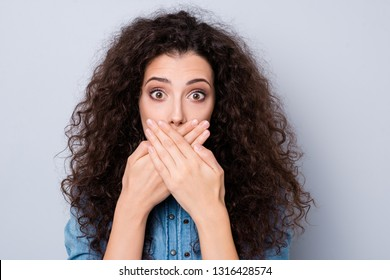 Close up photo amazing beautiful her she lady arm hiding mouth not talking telling speaking you know too much concept wearing casual jeans denim shirt clothes outfit isolated grey background