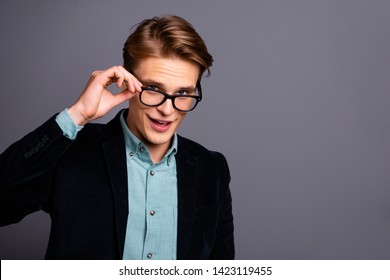 Close up photo amazing he him his guy macho flirty take off specs ideal perfect appearance hairstyle arms crossed easy-going chief leadership formal-wear shirt velvet jacket isolated grey background