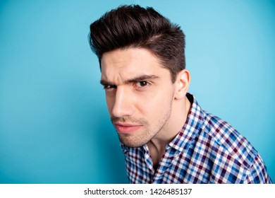 Close up photo amazing he him his macho listen wondered rumours chatterbox not believe inquisitive facial expression wait hear truth wear casual checkered plaid shirt isolated bright blue background