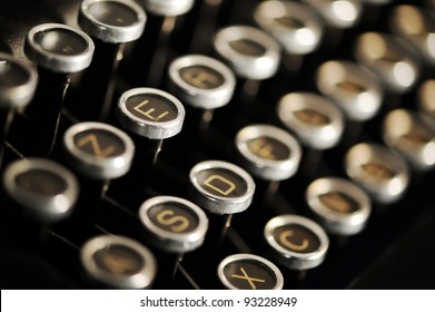 Close up photo of antique typewriter keys, shallow focus