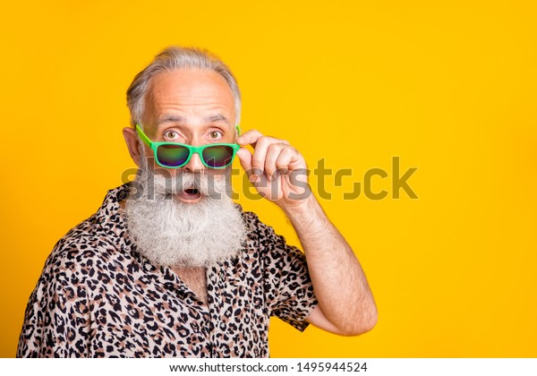 Close up photo of astonished man seeing something strange in front of him while isolated with yellow background