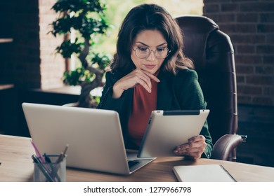 Close up photo of attentive attractive middle-aged gorgeous she her business lady sitting big office chair in specs e-book in hand interested in video lecture wearing formalwear suit