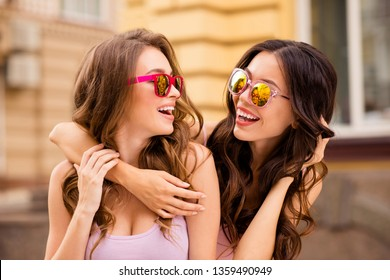 Close up photo attractive charming sweet trendy fellows fellowship student have enjoy free time travel trip laughter fool satisfied rejoice long hair colorful specs pink clothing spring town center