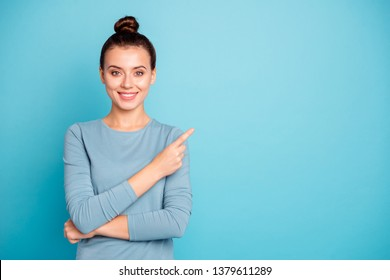 Close up photo beautiful amazing cute she her lady arm hand finger indicate empty space toothy advising buy buyer best low little price wear casual sweater pullover isolated blue bright background