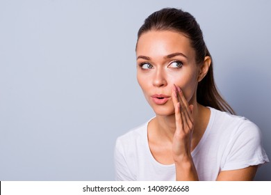 Close up photo beautiful amazing funky her she lady arm hand palm near mouth share news novelty rumours open mouth chatterbox bad silly person wear casual white t-shirt isolated grey background
