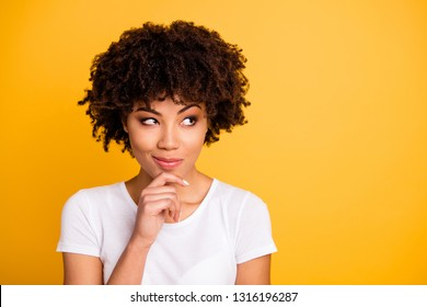 Close up photo beautiful amazing she her dark skin lady cool pretty look up to empty space hand touch chin remember address wear casual white t-shirt isolated yellow bright vibrant vivid background
