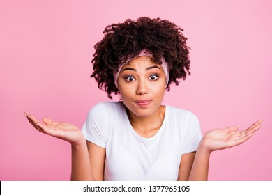 Close up photo beautiful amazing she her dark skin lady raised arms hands palms show it is not my fault facial expression wear head scarf casual white t-shirt isolated pink bright vivid background