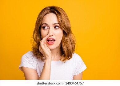 Close up photo beautiful amazing she her foxy lady hold arm hand talking tell speak say secrecy information news novelty not loud chatterbox wear casual white t-shirt isolated yellow background