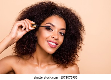 Close up photo beautiful amazing she her dark skin wavy model lady hold hands arms using new extra long lashes applicator advising buy buyer makeup studio nude isolated beige pastel background