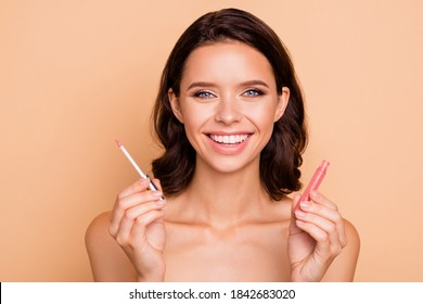 Close up photo beautiful amazing she her lady hold new collection pomade great result lipgloss go date choice choose color mirror shower bath wear nothing isolated beige pastel background