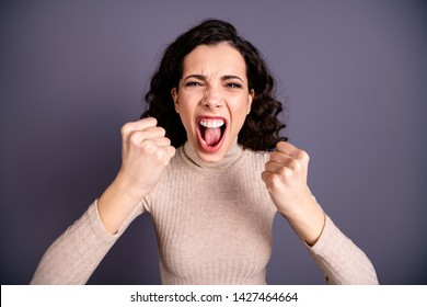 Close up photo beautiful amazing wild she her lady yelling loud not fair situation roar hands arms fists raised forward I would kill you face wear casual pastel pullover isolated grey background
